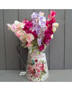 Artificial Sweet Peas in a Metal Jug
